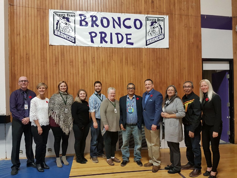 Special guests Ogichidaa Francis Kavanaugh, Grand Chief of Treaty No. 3, and Greg Rickford, Federal Minister of Indigenous Affairs pose for a photo with KPDSB staff