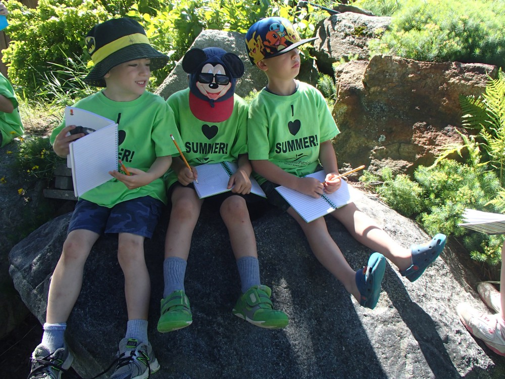 Students learning outside with KPDSB Summer Camps tshirts